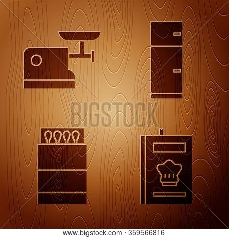 Set Cookbook, Kitchen Meat Grinder, Open Matchbox And Matches And Refrigerator On Wooden Background.