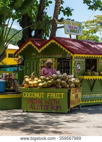 Ocho Rios, Jamaica - April 22, 2019: Ice Cold Coconut Fruit Drink With Rum Stall/corner Shop In Rast