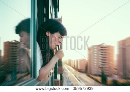 Infected Woman Peeks Out The Window For Coughing During Quarantine. Coronavirus Covid-19 Crisis. Emp