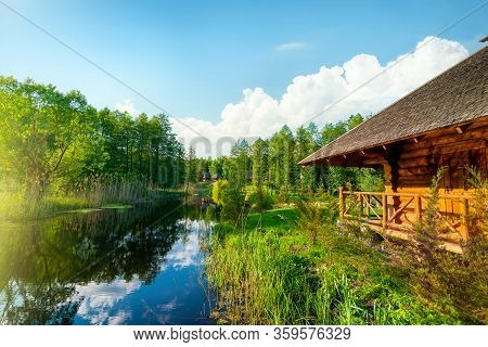 Landscape Pond And Forest In Spring Afternoon