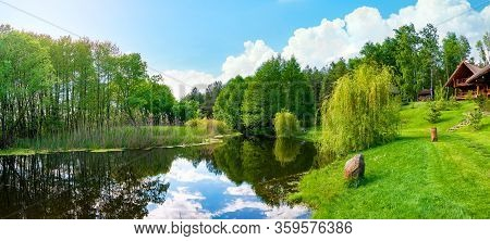 Landscape Pond And Field In Spring Afternoon