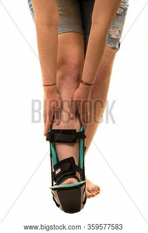 Part Of Woman Body With Foot Orthosis Isolated On White Background