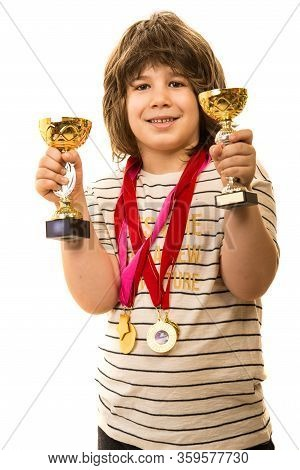 Happy Champion Boy Showing His Trophies Isolated On White Background