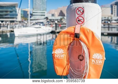 Sydney, Australia - July 23, 2017: Bright Orange Water Protection Inflatable Lifesaver Buoy With Nsw