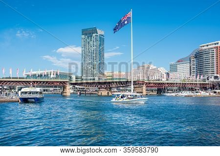 Sydney, Australia - July 23, 2017: Darling Harbour Harbourside With Luxury Waterfront Hotels And Res