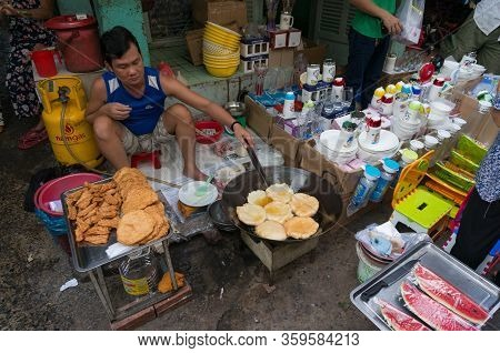 Ho Chi Minh, Vientam - August 25, 2017: Man Cooking Traditional Vietnamese Fried Snack In Street Foo
