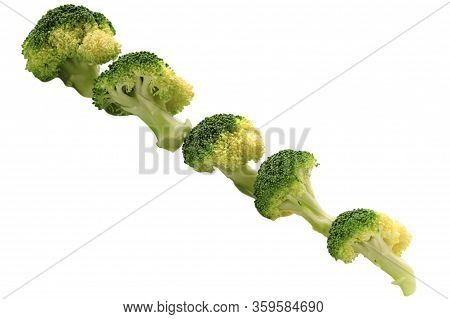 Fresh Broccoli Florets Vegetables Row Isolated On White Background. Close Up. Selective Soft Focus.