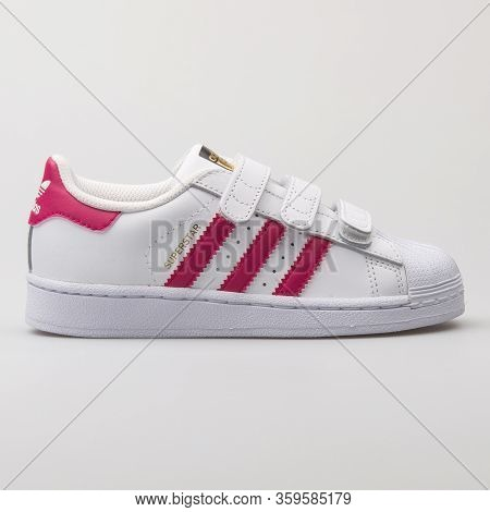 Vienna, Austria - August 6, 2017: Adidas Superstar Foundation Cf White And Pink Sneaker On White Bac