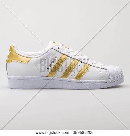 Vienna, Austria - August 6, 2017: Adidas Superstar White And Yellow Sneaker On White Background.