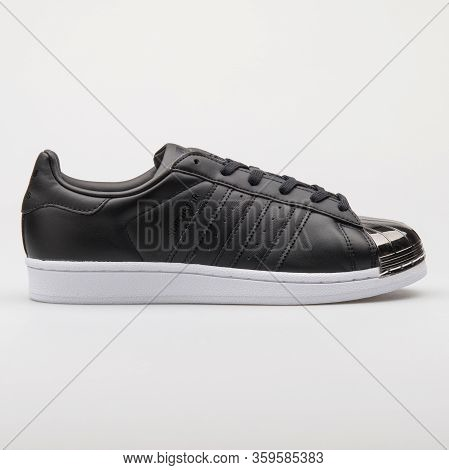 Vienna, Austria - August 6, 2017: Adidas Superstar Metal Toe Black And White Sneaker On White Backgr