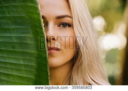 Close Up Portrait Of Pretty Caucasian Lady With Blonde Hair, Natural Makeup, Clean Fresh Skin, Hidin