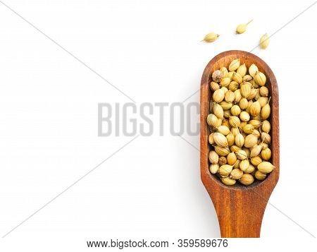 Spice Coriander (coriandrum Sativum) Seeds In Wooden Scoop Isolated On White Background. Healthy Eat