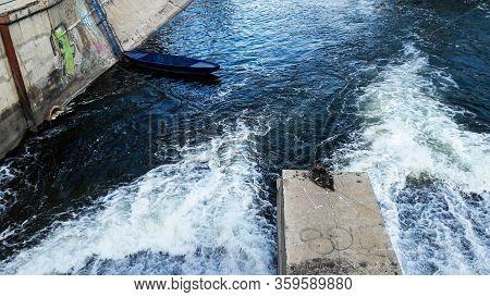 Bucharest, Romania - June 16, 2019: Duck And A Boat On Dambovita River, United Nations (natiunile Un