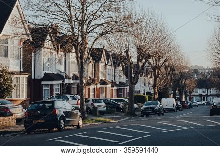 London, Uk - March 22, 2020: Cars Parked In Front Of A Row Of Edwardian Houses On A Street In Palmer