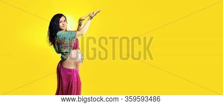 Pregnant Happy Woman In Indian Sari With Mehendi Tattoo Painted With Henna On Belly, Fun Fooling Ove