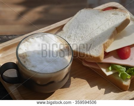 Romantic Breakfast In Bed Concept Composition, Tray With Sandwich And Cup Of Coffee Cupuchino, Wood