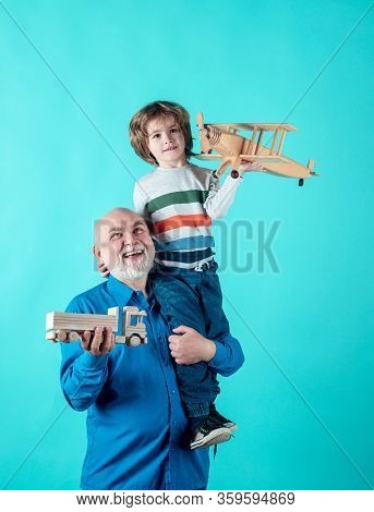 Portrait Grandpa And Grandson Playing With Toys Plane. Family Relationship Grandfather And Grandson.