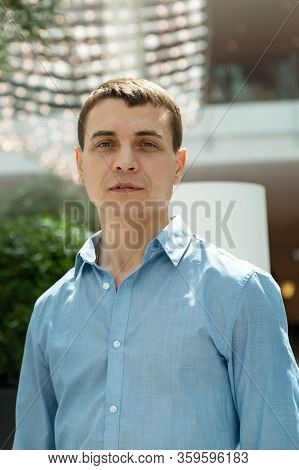 A 30-35 Year Old Man In A Blue Shirt. Portrait Of An Adult Caucasian Man With A Blue Shirt.
