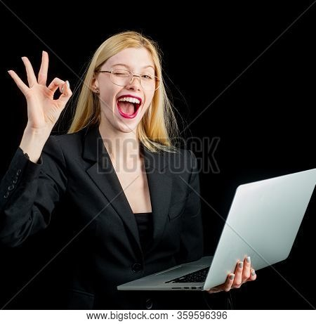 Portrait Young Shocked Business Woman Winking In Front Of Laptop Computer Looking At Camera. Funny F