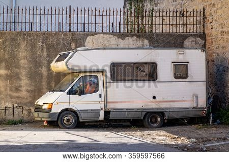 Palermo, Sicily - February 8, 2020: The Old Abandond Ford Transit Rv Vehicle In The Streets Of Paler