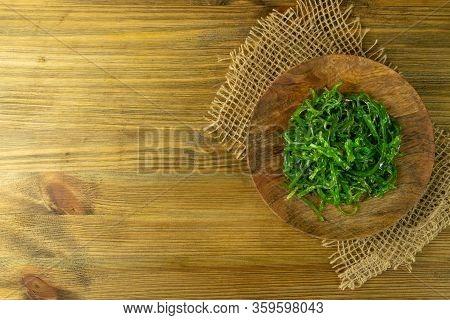 Chukka Seaweed Salad Or Sea Kelp Salat On Rustic Background