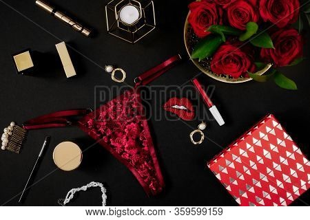 Sexy Seductive Lingerie On Black Background. Female Accessories For Seduction And Date Concept. Flat