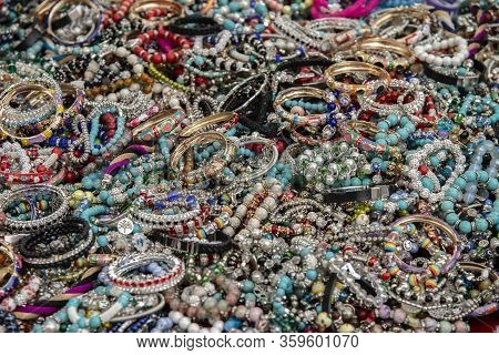 Colorful And Inexpensive Costume Jewelry At The Local Market In Rome, Italy.