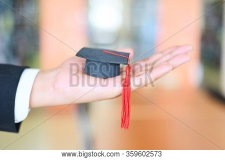 Graduation Education Business Study Concept / Business Man Or Student With Graduation Cap On Hand In