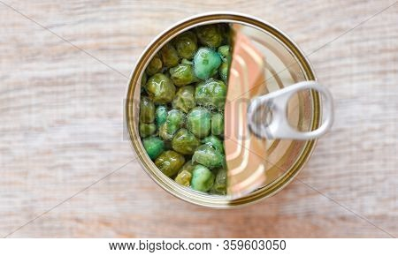 Canned Food In Metal Can On Wooden Background , Top View / Canned Goods Non Perishable Food Storage