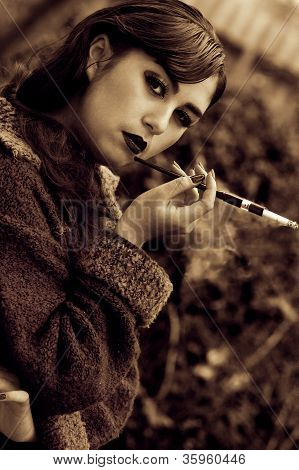 Beautiful Retro Stylized Photo Of A Sexy Woman With Cigarette