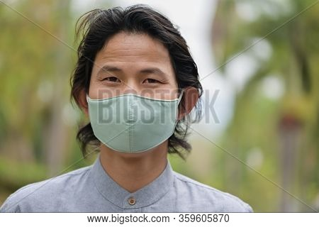 Man Wearing A Cloth Mask In Public Area Protect Himself From Risk Of Disease, People Prevent Infecti