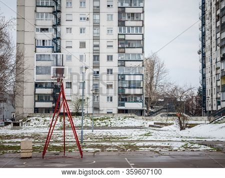 Decaying Basketball Playground In Front Of Communist Buildings In The District Of Novi Beograd, Or N