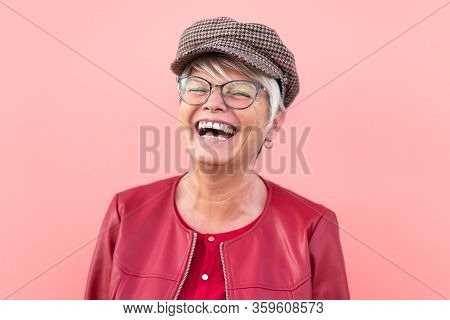 Happy Senior Woman Having Fun Outdoor - Trendy Mature Person Laughing And Enjoying Retired Time - El