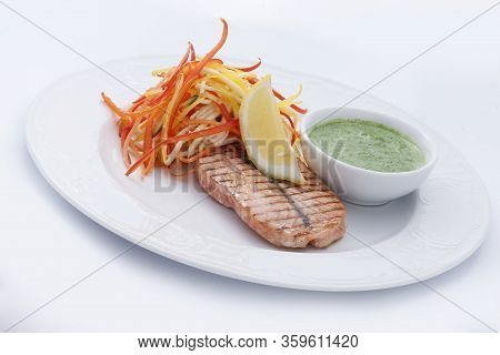 Grilled Salmon With Grated Vegetables , Sauce And Lemon