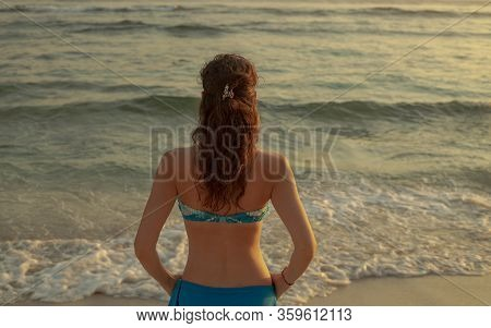 Young Woman Practicing Pranayama And Meditation. Hands In Gyan Mudra. Sunset At The Beach. Calm Mind