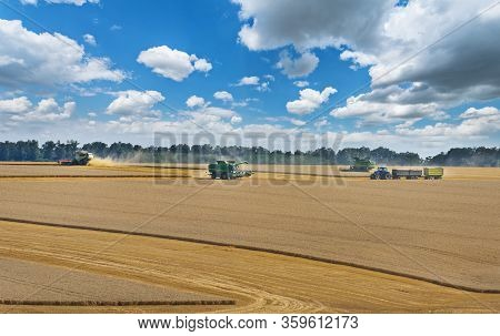 Dobrich, Bulgaria - July 07. 2019: Modern John Deere Combine Harvesting Grain In The Field Near The