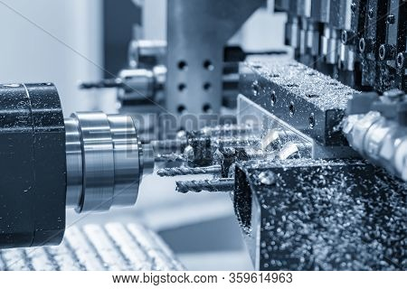 The  Multi-tasking Cnc Lathe Machine Making The Thread At The Brass  Shaft Parts With Tapping Tool.