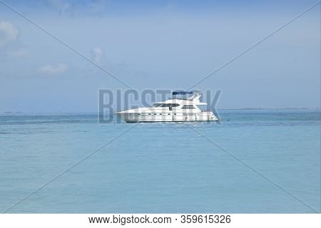 Super Luxury Motor Yacht Stopped In Front Of A White Caribbean Beach. White Beach And Crystal Clear