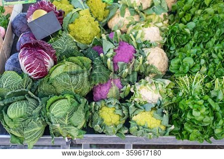 Purple, Cauliflower, Red Cabbage And Watercress At The Market