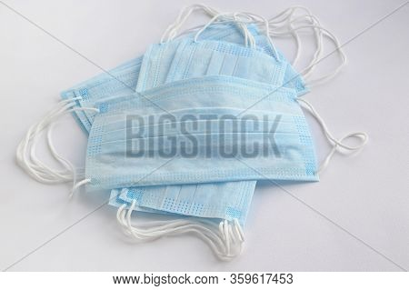 Disposable Blue Face Masks To Stop Viruses On A Light Background