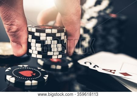 Poker Player Placing Bid Closeup Photo. Gambling Industry Concept With Casino Chips.