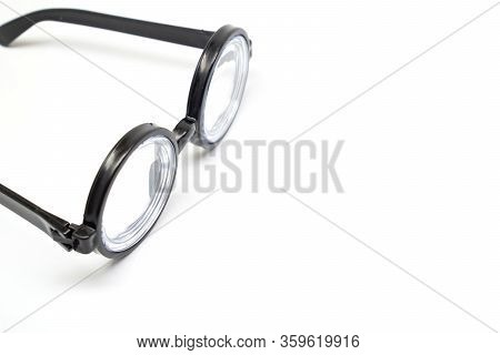 Round Black Rimmed Glasses With Thick Lenses. Of Poor Vision. Isolate On White Background. Funny.