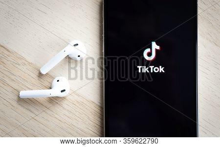 Sankt-petersburg, Russia, April 5, 2020: Tik Tok Application Icon On Apple Iphone Xs Max Screen Clos