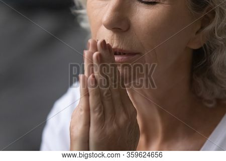 Peaceful Elderly Senior Woman Praying God With Namaste Gesture.
