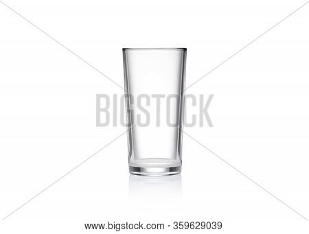 Empty Glass Of Glass On A White Background. Glass Cup Isolate Closeup. Glass On A Mirror Surface.