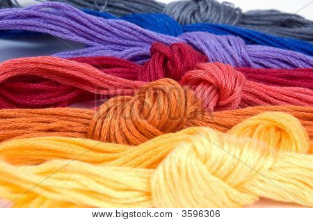 Several Lying Buns Of Colorful Sewing