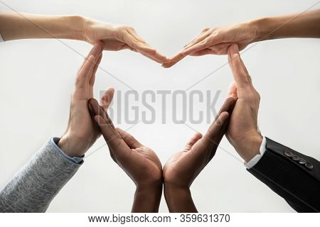 Concept Of Diverse Business People Join Hands Forming Heart.