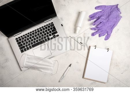 Online Work And Education In Conditions Of Quarantine. Stay At Home. Laptop, Notebook, Pen, Surgical