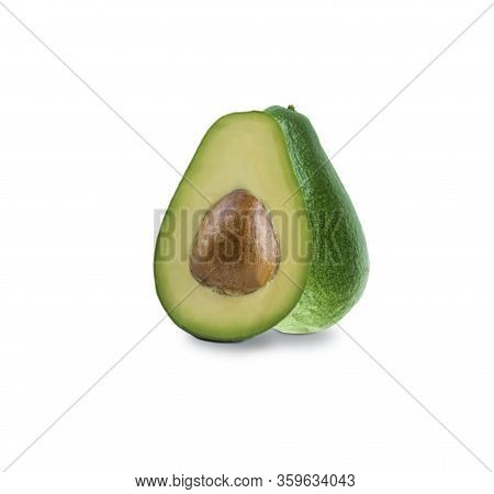 Sliced Avocado Isolated. Cut Avocado Fruit Isolated On White Background. Avocado With Copy Space For