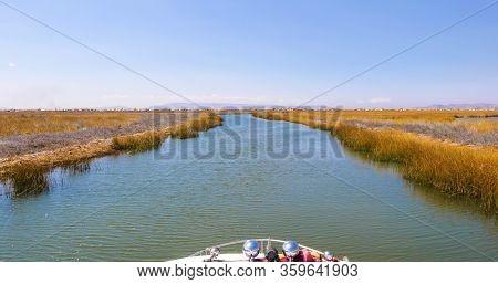 Peru Lake Titicaca Waterways Between The Floating Islands With Sun